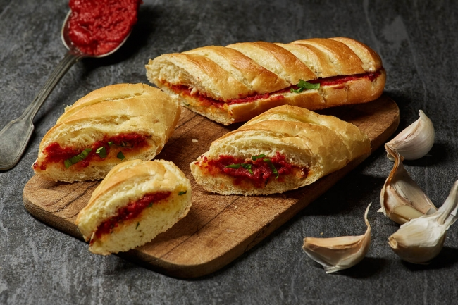 Baguette with garlic and tomato paste
